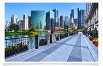 Skyline and sidewalk along Chicago River