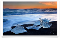 Icebergs along black sand beach 1